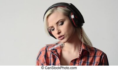 beautiful and sexy woman dancing in headphones