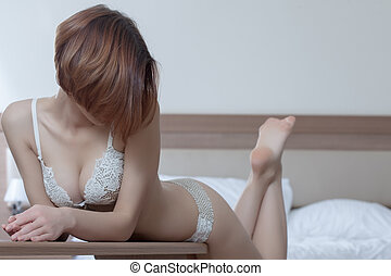 Beautiful and sexy woman in bedroom