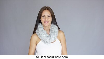 Beautiful and sexy woman posing with woolen scarf