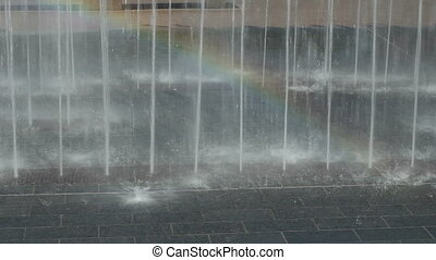 Beautiful and Wet - Water jets spraying H20 up out of paver...