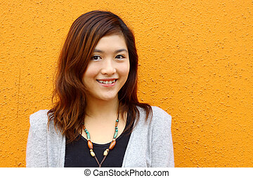 Beautiful and young Asian woman smiling
