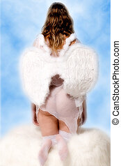 Beautiful angel in the clouds watching