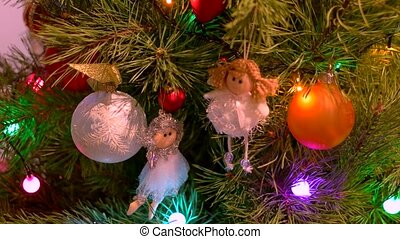Beautiful angels figurines hanging on Christmas tree. Close...