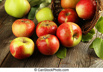 Beautiful apples on brown wooden background