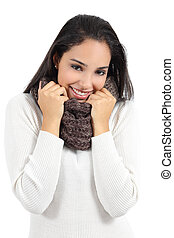 Beautiful arab woman warmly clothed grabbing a scarf