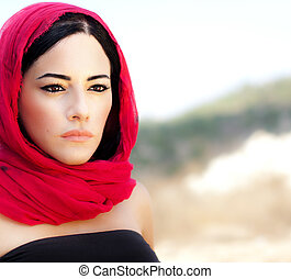 Beautiful arabic woman wearing red scarf, traditional muslim...