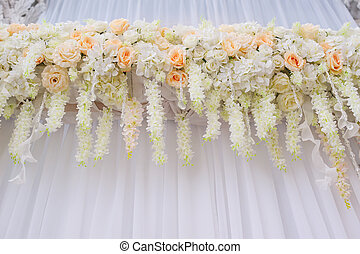 beautiful arch with white roses for wedding ceremony