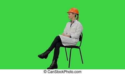 Beautiful architect giving an interview on a Green Screen, Chroma Key.
