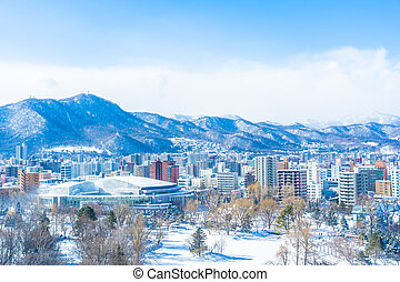 Beautiful architecture building with mountain landscape in winter season Sapporo city Hokkaido Japan