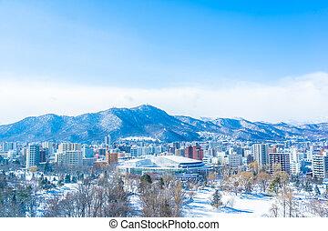 Beautiful architecture building with mountain landscape in winter season Sapporo city Hokkaido Japan