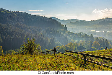 fence through hillside with rural fields - beautiful area in...