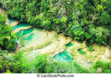 Beautiful arial view of turquoise waterfalls Semuc Champey...