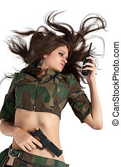 Beautiful army girl holding pistol and radio