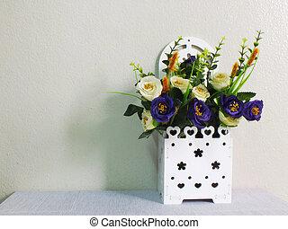 beautiful artificial flower in white basket