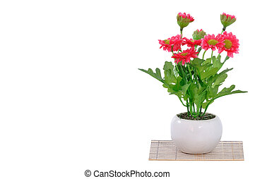 Beautiful Artificial flower in white pot on mat