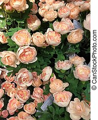 Beautiful artificial pink roses on the market