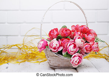roses in a wicker basket