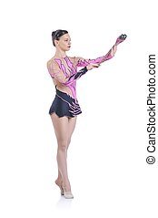 Beautiful artistic female gymnast working out, performing art gymnastics element