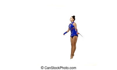 Beautiful artistic gymnast jumping rope, slow motion