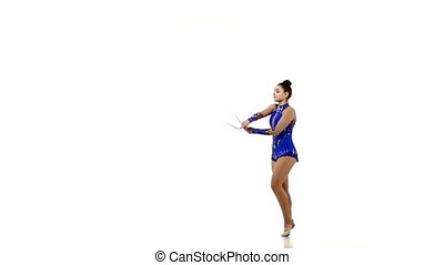 Beautiful artistic gymnast jumping with rope, slow motion
