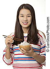 Asian American woman eating a bowl of rice