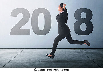 Happy New Year 2018 - Beautiful asian business woman running...