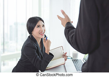 Beautiful asian businesswoman discussion with partner in office