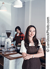asian cafe owner smiling to camera