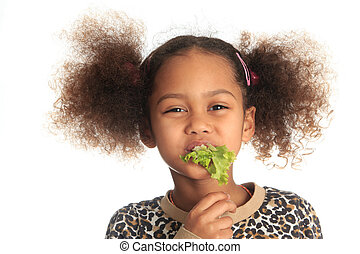 beautiful asian child African American Black child eats salad isolated metisse