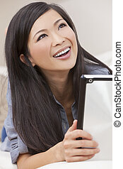 Beautiful Asian Chinese Woman Using Tablet Computer