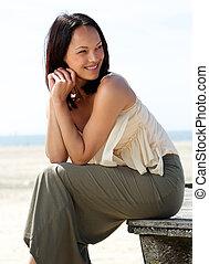Beautiful asian female model smiling outdoors