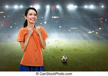Beautiful asian football player woman with happy expression