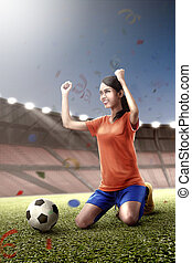 Beautiful asian footballer woman with happy expression