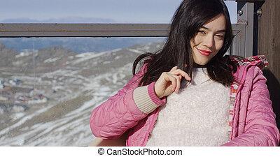 Beautiful asian girl enjoys sunny winter weather
