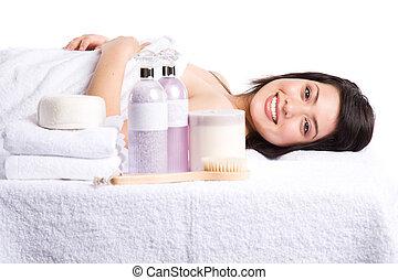 Beautiful asian girl in a spa