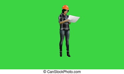Beautiful asian girl laughing throwing pieces of paper on a Green Screen, Chroma Key
