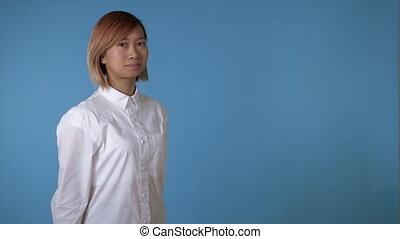 beautiful asian girl posing winks - young korean female...