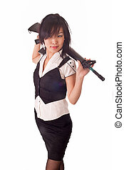 Beautiful asian girl with rifle on her shoulders