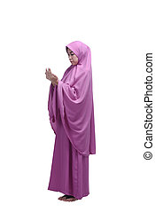 Beautiful asian muslim woman wearing hijab praying