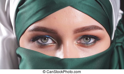 Beautiful asian muslim woman with niqab traditional veil...