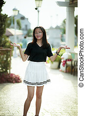 beautiful asian teenager with unhappy face standing outdoor