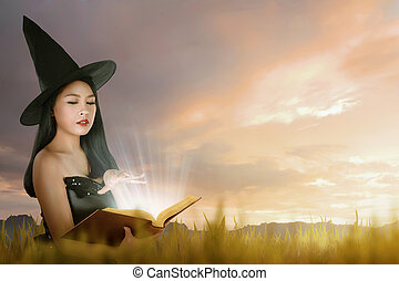 Beautiful asian witch woman with hat learning magic from the book