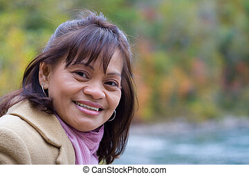 A closeup of a beautiful asian woman