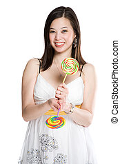 Beautiful asian woman and lollipops