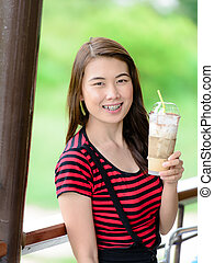 Beautiful Asian woman drinking coffee.