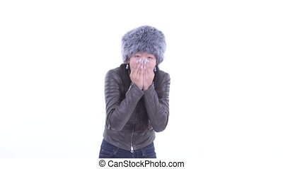 Beautiful Asian woman feeling cold and shivering - Studio ...