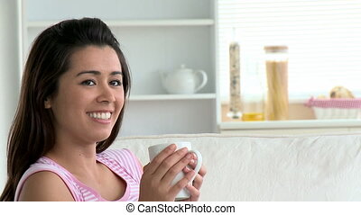 Beautiful asian woman holding a cup
