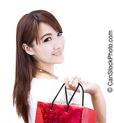 beautiful asian woman holding shopping bag