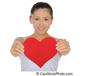 beautiful Asian woman holds out the heart