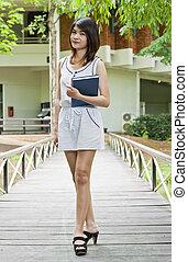 Beautiful Asian woman in campus.
